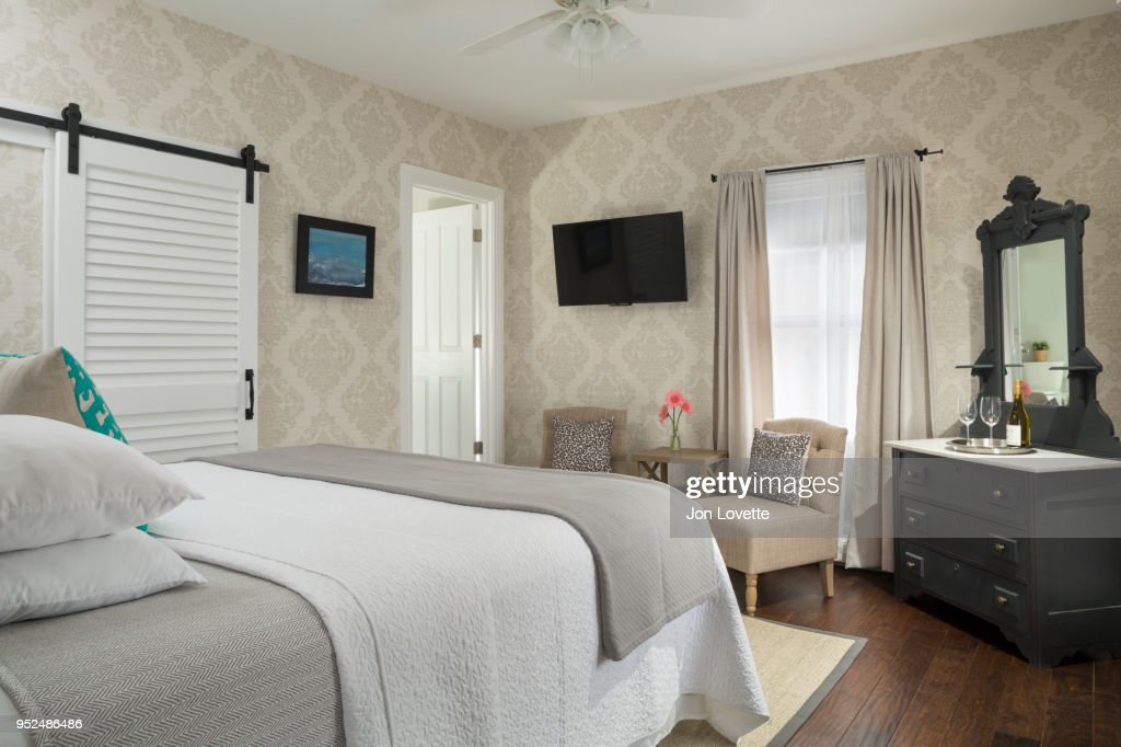 Bedroom Interior With Tan Wallpaper And Sliding Barn Door Closet High Res Stock Photo Getty Images