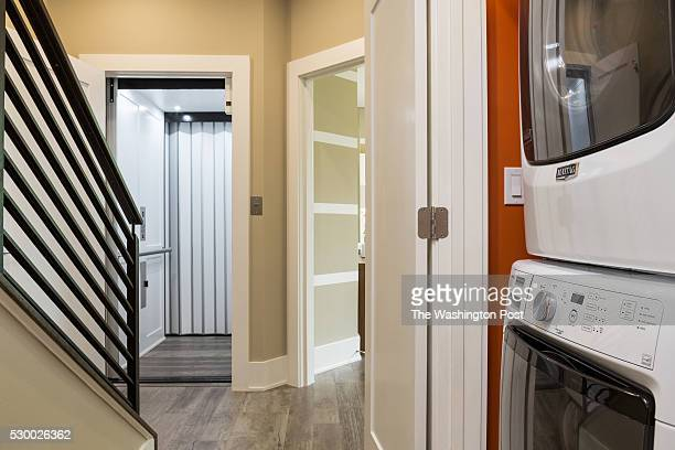 Bedroom Level Hall with Elevator and Laundry in the Model at Grosvenor Heights on May 3 2016 in Bethesda Maryland