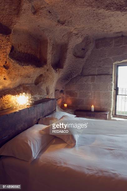 Bedroom of the hotel Le Grotte della Civita located in the Sassi di Matera that represents the almost paradigmatic expression of the Minor Historical...