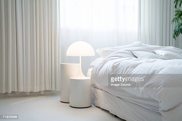 bedroom - electric lamp stock pictures, royalty-free photos & images