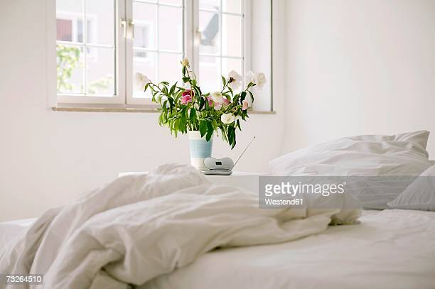 Bedroom with vase of flowers
