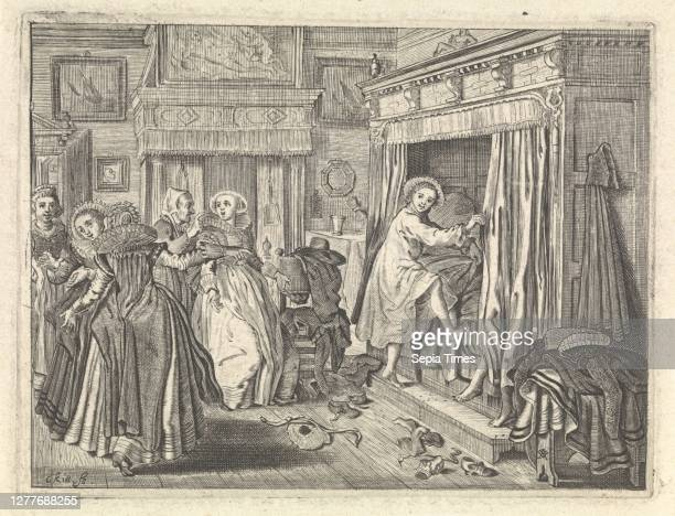 Bedroom scene In a richly decorated bedroom a girl gets into her bedstead while a group of five elegantly dressed ladies are laughing Two feet come...