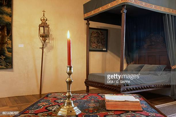 Bedroom with a canopy bed Chateau de Chabans SaintLeonsurVezere Aquitaine France 13th17th century