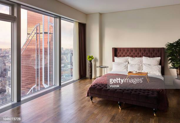 bedroom with a panoramic view of moscow-city - double bed stock pictures, royalty-free photos & images