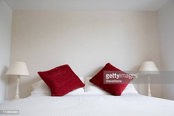 Bedroom with red cushions