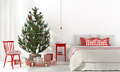 Bedroom with red decorations and Christmas tree