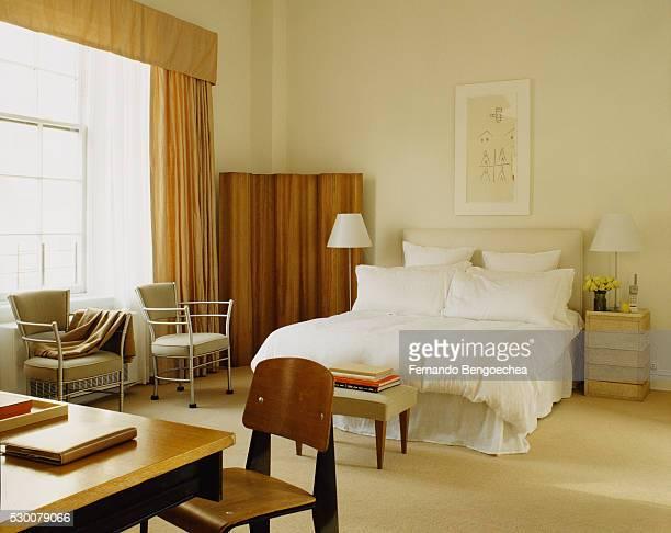 Bedroom with Wooden Screen in Corner