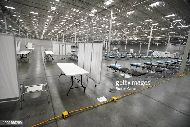 Beds and makeshift hospital rooms are set up inside a former Lowe's building in North Kingston, RI on April 8, 2020. As Rhode Island prepares for an...