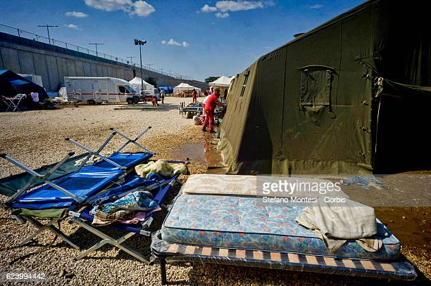 Beds and mattresses placed in the sun to dry A tent that housed migrants flooded from rain at a camp setup by the Red Cross close to the Tiburtina...