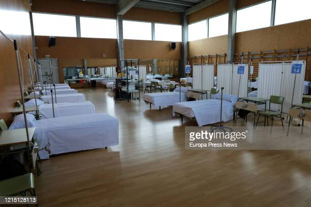 Beds and screens are seen at the hospital prepared by parachutist sappers at the sports centre of the scientific campus of the University of Alcala,...