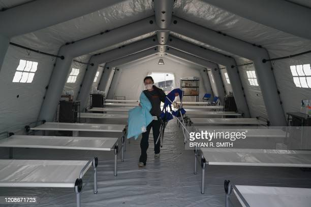 TOPSHOT Beds are lined up in a tent as volunteers from the International Christian relief organization Samaritans Purse set up an Emergency Field...