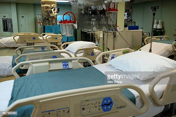 Beds are prepared in the intensive care unit section of the Navy hospital ship USNS Comfort during a media tour of the ship January 15 2010 in...