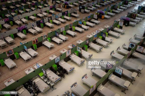 Beds for Covid19 patients fill the floor in a temporary coronavirus hospital at Iran Mall in Tehran Iran on Monday April 13 2020 Iran is seeking to...
