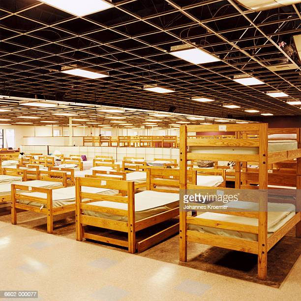 beds in homeless shelter - homeless shelter stock pictures, royalty-free photos & images