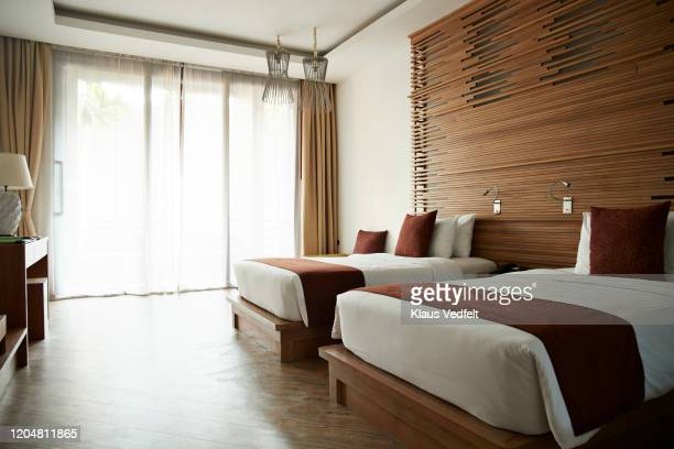 beds in hotel room at tourist resort - hotel stock pictures, royalty-free photos & images