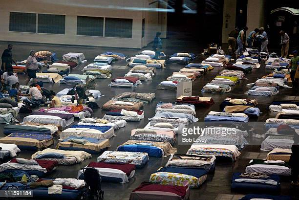 Beds in the George R Brown Convention Center are readied for evacuees from New Orleans as they arrive at the George R Brown Convention Center...