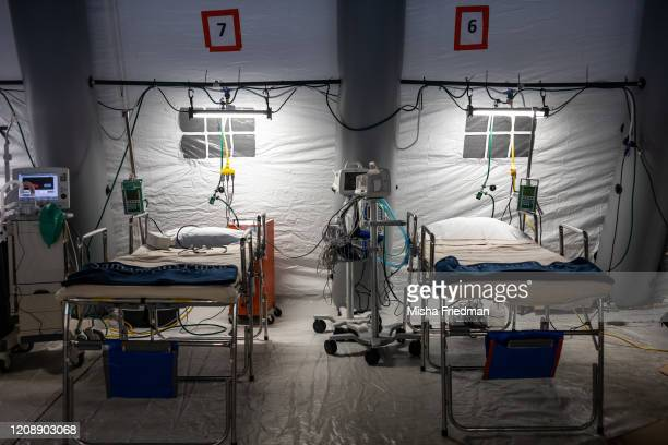 ICU beds of a makeshift temporary hospital at Central Park East Meadow in New York City US on March 31 2020The Coronavirus pandemic has spread to...