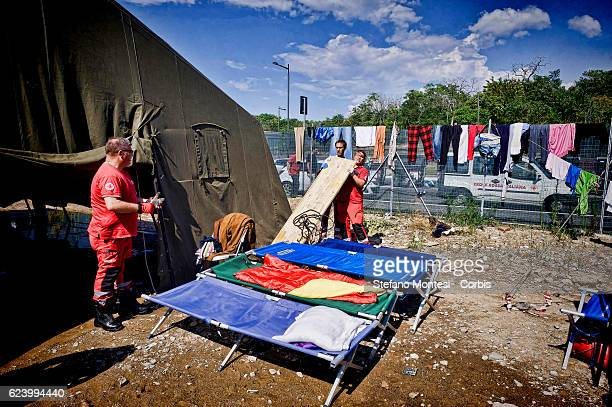 Beds placed in the sun to dry A tent that housed migrants flooded by rain at a camp setup by the Red Cross close to the Tiburtina train station in...