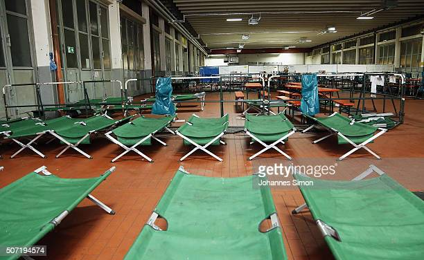 Beds ready for use for migrants and refugees are prepared at a processing center on January 27 2016 in Passau Germany The flow of migrants arriving...