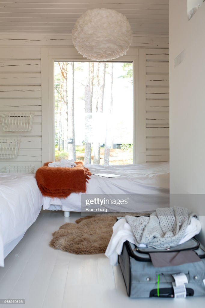 Beds sit in a guest cabin on SuperShe island near Raasepori, Finland, on Wednesday, June 27, 2018. The price of experimental networking on the island that has banned men, and only accepts heavily vetted women, is 4,000 euros, or $4,600. The package includes self-help tools that can lead participants down a different career path, as well as cognitive training to expel any negative thoughts. Photographer: Heli Blafield/Bloomberg via Getty Images