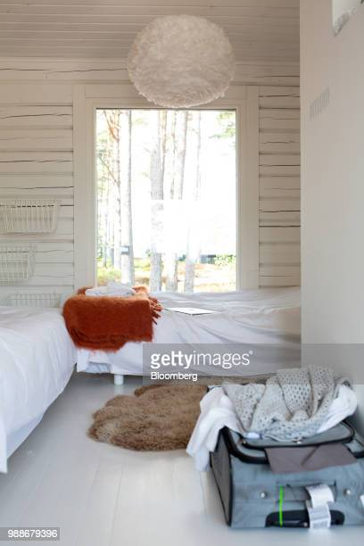 Beds sit in a guest cabin on SuperShe island near Raasepori, Finland, on Wednesday, June 27, 2018. The price of experimental networking on the island...