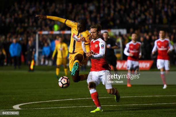 Bedsente Gomis of Sutton United battles for the ball with Nacho Monreal of Arsenal during the Emirates FA Cup fifth round match between Sutton United...