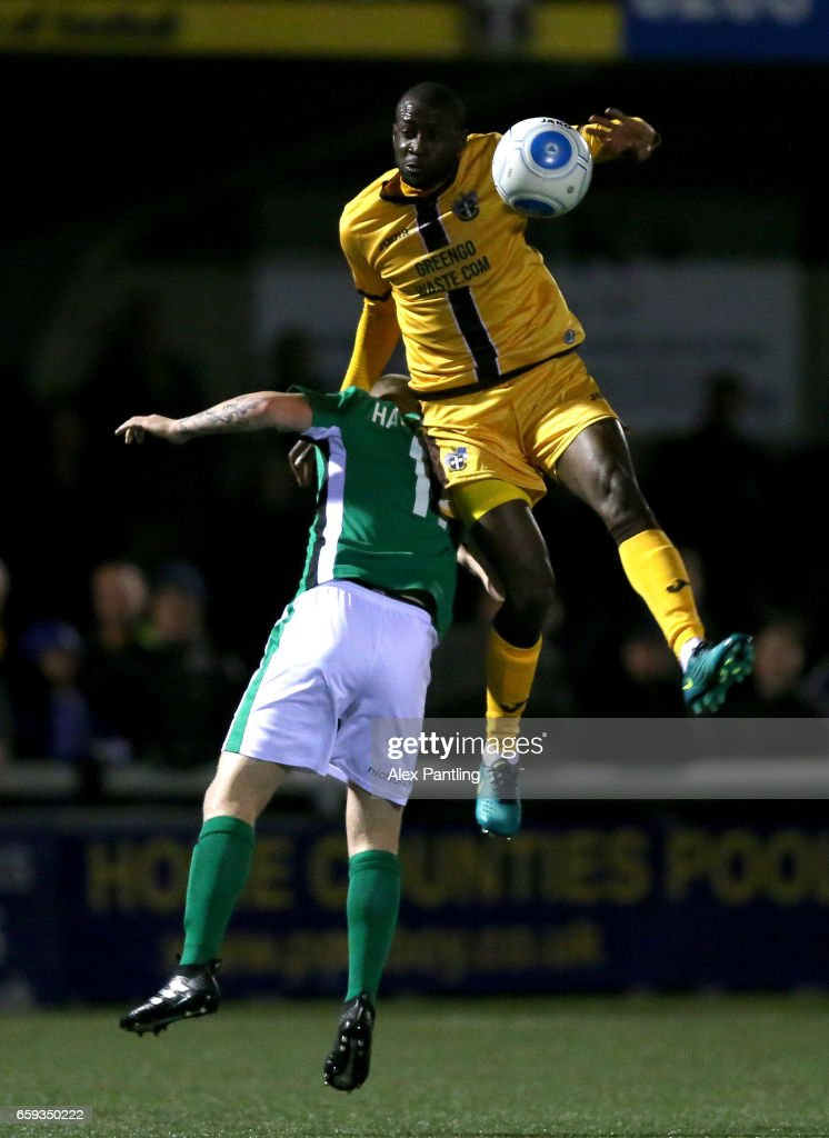Bedsente Gomis of Sutton United wins a header during the Vanarama National League match between Sutton United and Lincoln City at Gander Green Lane on March 28, 2017 in Sutton, Greater London.