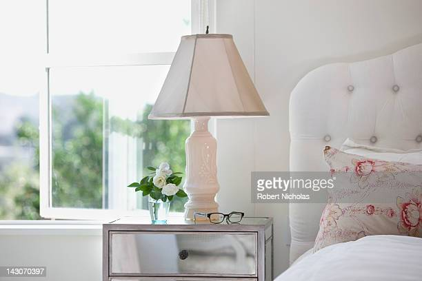 Bedside table and lamp in bedroom