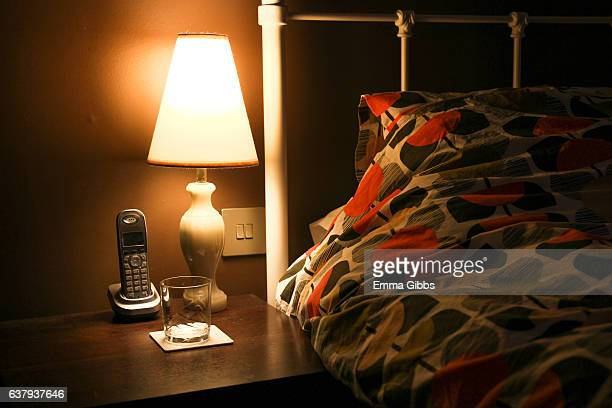 bedside table - lamp stock photos and pictures