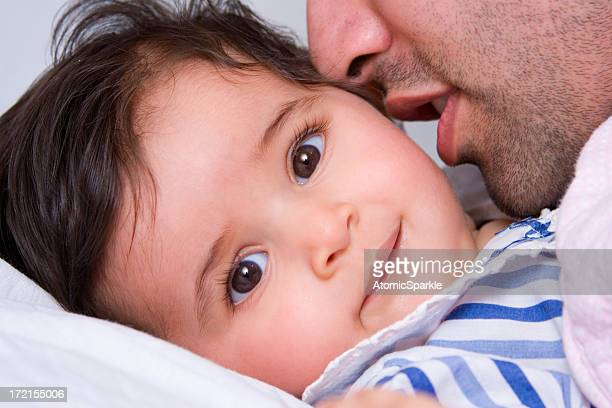 bedtime baby girl - indian girl kissing stock photos and pictures