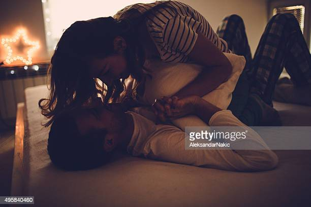 bedtime - couple and kiss and bedroom stock photos and pictures