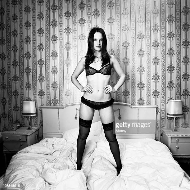 bedtime portrait - confident woman posing in lingerie bw - stockings photos stock photos and pictures