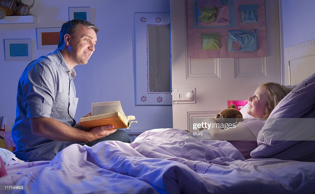 Bedtime story stock photo getty images for Bed stories online