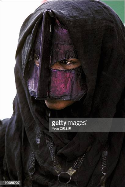 Bedu woman wearing a Bourqa These Bedouins are nomads living in the Wahiba desert in Oman