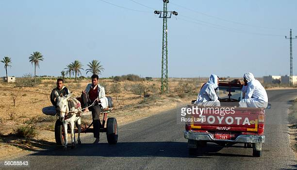Beduin tribesmen travel the roads in ancient and modern transport in arrid saroundings on the Sinai Peninsula between Egypt and Israel