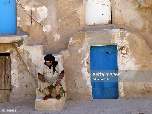 Beduin using a mobile phone in Medenine town, Medenine, Tunisia.
