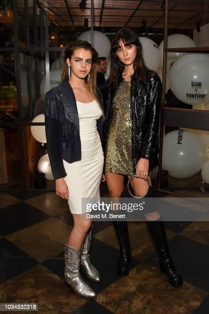 Bee Beardsworth and Valentina Ruby attend the Izzue x Ponystep London Fashion Week party at Mare Street Market on September 16 2018 in London England