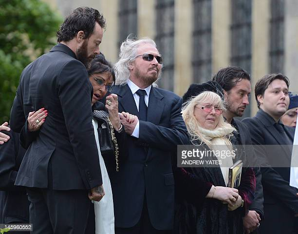 Bee Gee Barry Gibb, and Dwina Murphy Gibb, and Robin-John Gibb brother, wife and son of Robin Gibb, attend his funeral service at St Mary's Church in...