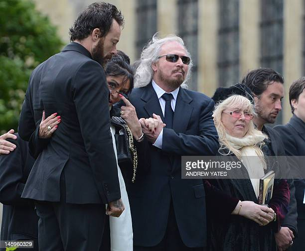 Bee Gee Barry Gibb, and Dwina Murphy Gibb, brother and wife of Robin Gibb, attend his funeral at St Mary's Church in Thame, central England, on June...