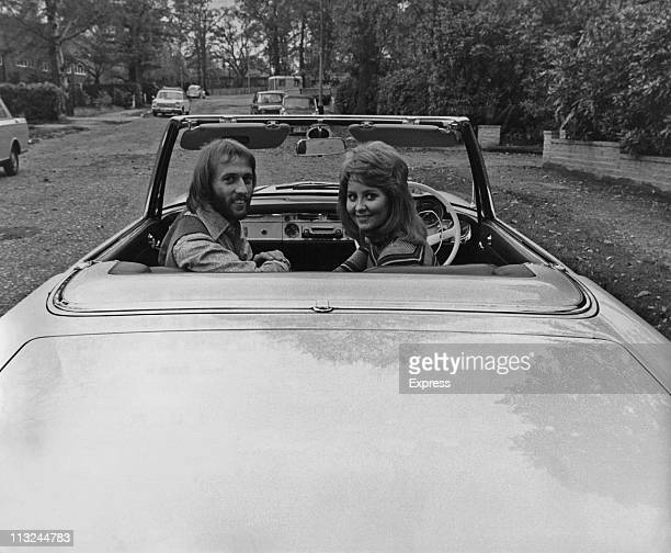 Bee Gee Maurice Gibb with his wife singer Lulu sitting in a Mercedes that he had given her as a birthday present on November 05, 1970.