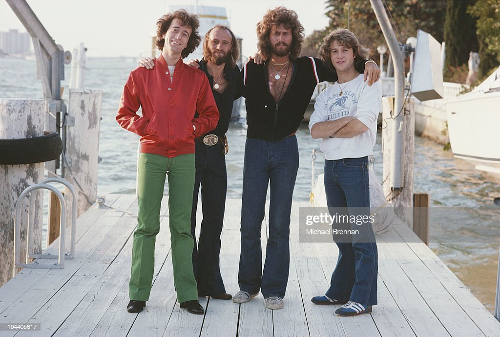Bee Gees (left to right) Robin, Maurice and Barry Gibb with their brother Andy Gibb (1958 - 1988) in Miami, Florida, March 1978.