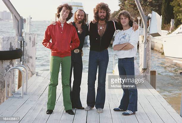 Bee Gees Robin Maurice and Barry Gibb with their brother Andy Gibb in Miami Florida March 1978