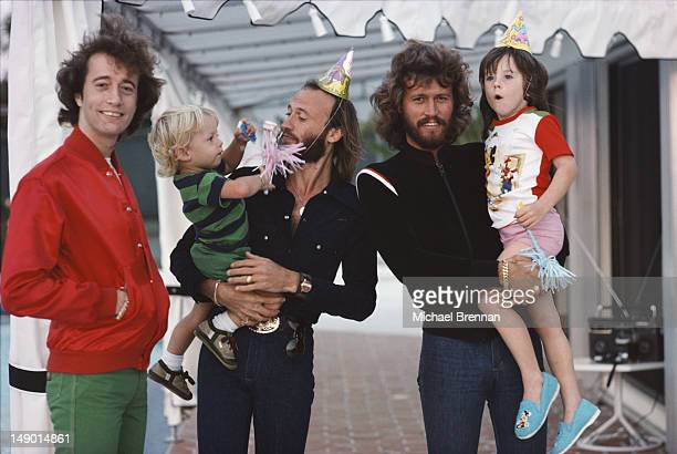Bee Gees Robin, Maurice and Barry Gibb with their children in Miami, Florida, March 1978.