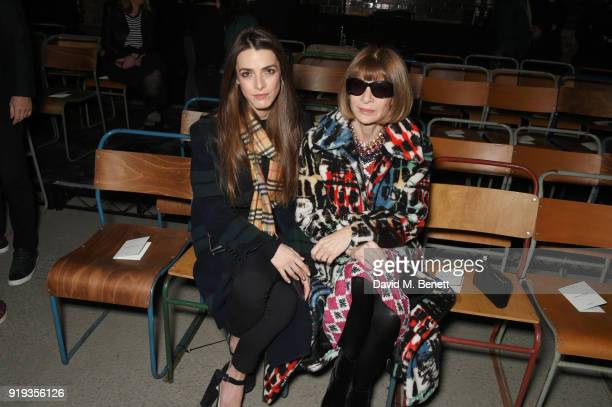 Bee Shaffer and Anna Wintour wearing Burberry at the Burberry February 2018 show during London Fashion Week at Dimco Buildings on February 17 2018 in...