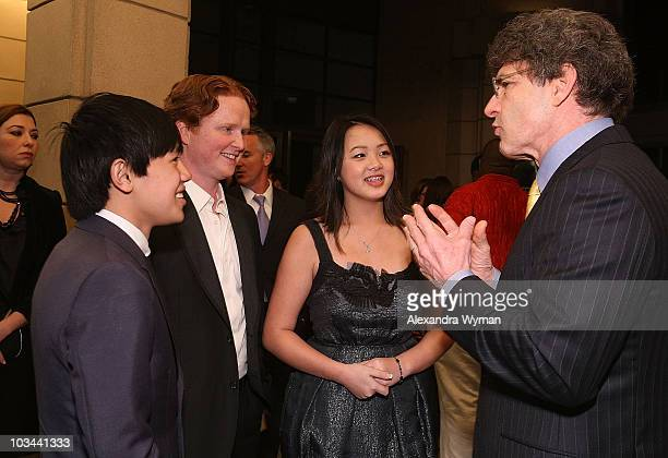 Bee Vang Christopher Carley Ahney Her and Alan Horn arrive on the red carpet for the Los Angeles premiere of Gran Torino at the Steven J Ross Theater...
