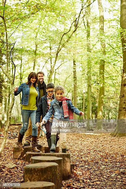 Beech woods in Autumn. A family with two children.