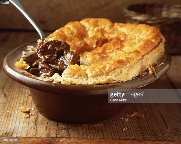 Beef and ale puff pastry pie in oval dish
