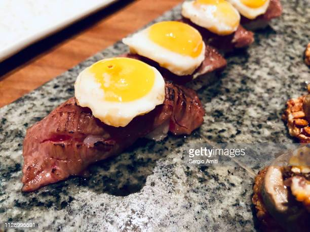 Beef and quail egg nigiris