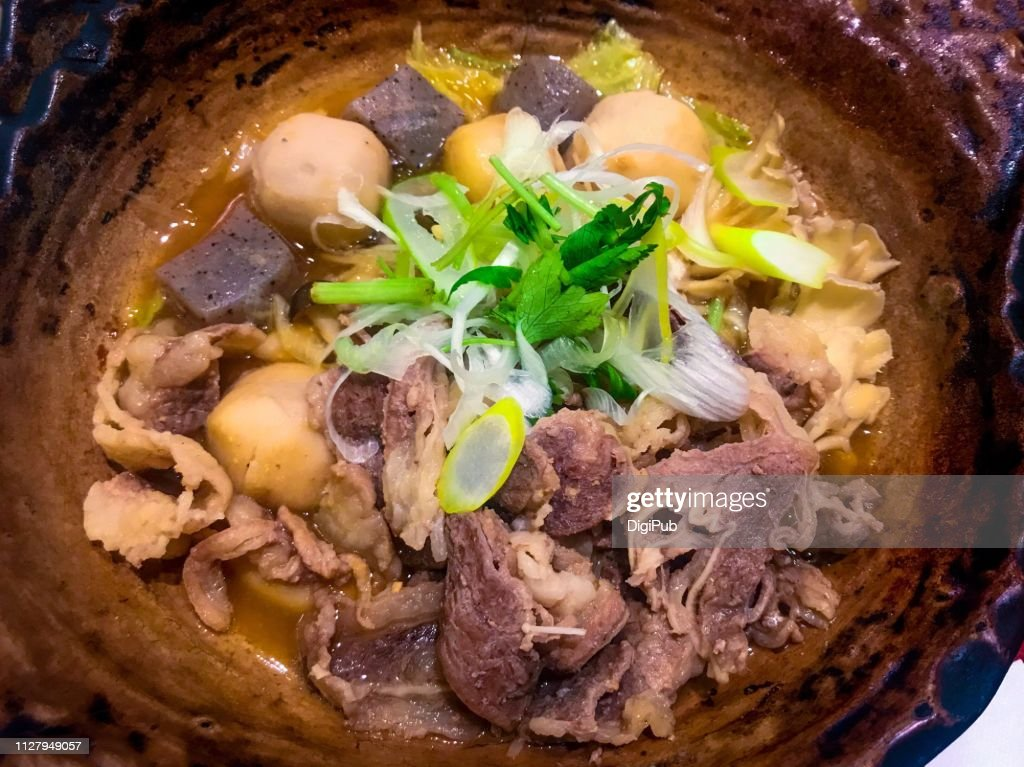 Beef and taro simmered with miso in earthen pot : Foto de stock