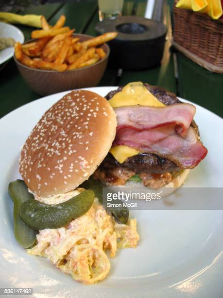 Beef, bacon and cheese hamburger served with pickles, coleslaw and fries